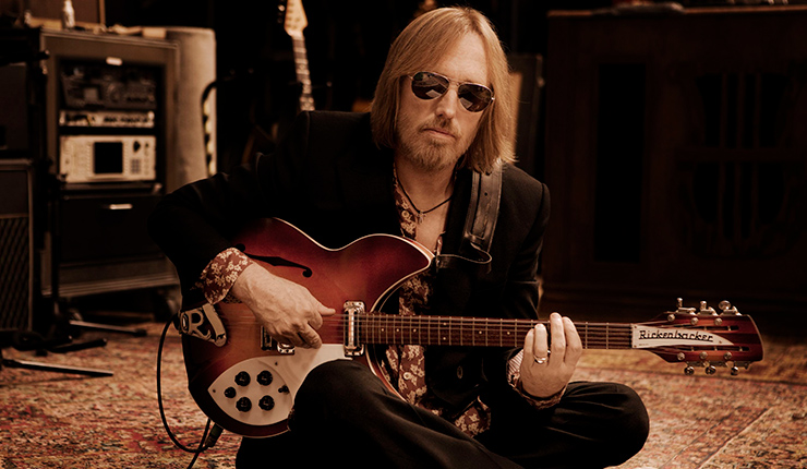 image of music legend Tom Petty playing the electric guitar